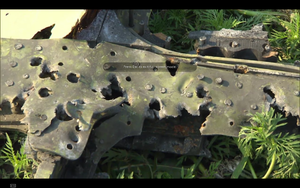 MH17 cockpit right window frame bullet holes.png