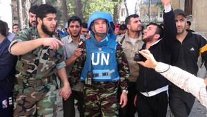Syrian Abdul Razzaq Tlas Lleader Of The Opposition Katibat Al Faruq Walks With Moroccan UN Observer Colonel Ahmed Himmiche C During