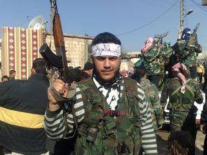 Taldou figters ride Taliban.jpg