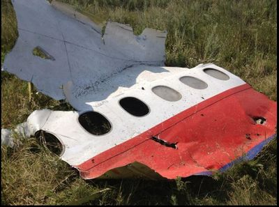 Maidan-24-July-fuselage-shrapnel-damage.jpg