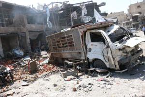 Douma Market attack truckdamage.png