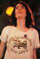 Patti Smith 1976 July 9 Central Park concert with Yippie cannabis flag pin.jpg
