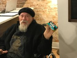 John Sinclair purchases recreational cannabis on Dec 1, 2019 in Ann Arbor, Michigan on opening day.jpg