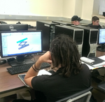 Joe working on Solidworks with prilminary scissor design