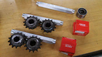 Intermediate axles with sprockets and bearings.