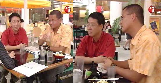 Singaporean gay activists Alex Au and Kelvin Wong during a television interview on Channel i News in July 2003.