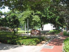 View of one of Hong Lim Park's signboards with the fountain on the right
