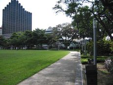 The perimeter footpath with Furama Hotel visible in the background.