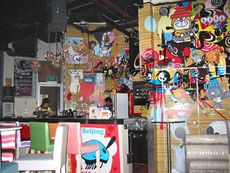 Bar and uniquely decorated walls of Cocco Latte's interior.