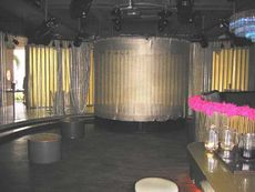 Dance floor and curtained stage in Happy.