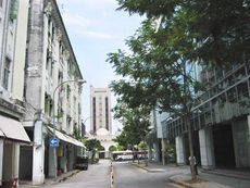 Row of shophouses on the left along Loke Yew Street, where Towel Club is located.