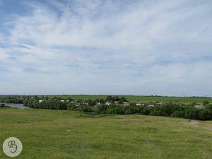 Вид на бывшую деревню Благодатку со стороны Благодатовского песчаного карьера (2013)